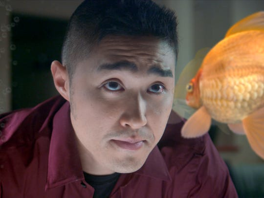 "Conner (Roger An) faces off with his goldfish, Rodrigo, in a scene from ""Alpha Fish."""