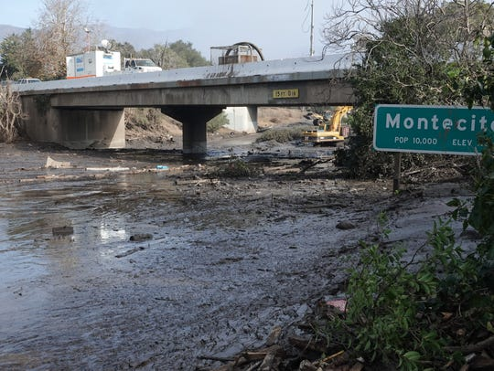 Mud and debris covered Highway 101 during a January 2018 mudslide in Montecito.