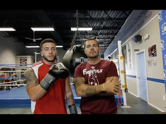 Augustus, aka Michael Marino (left) hangs out in the Joe Hand Boxing Gym in Camden in this scene from his video.