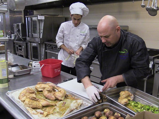 Will Matthews, 16, of Tompkins Cove, and chef Kendell Brenner, instructor at the Rockland BOCES Culinary Arts school in West Nyack, prepare some food at the school's teaching kitchen on Feb. 5. The school will host a Restaurant Night in conjunction with NoCo Catering and Events.