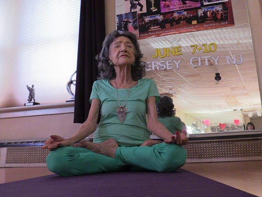 Tao Parchon-Lynch, who will turn 100 in a few months, is the world's oldest yoga teacher and the founder of the Westchester Yoga Institute, leads a class at the Fred Astaire Studio in Hartsdale on Feb. 5, 2018.