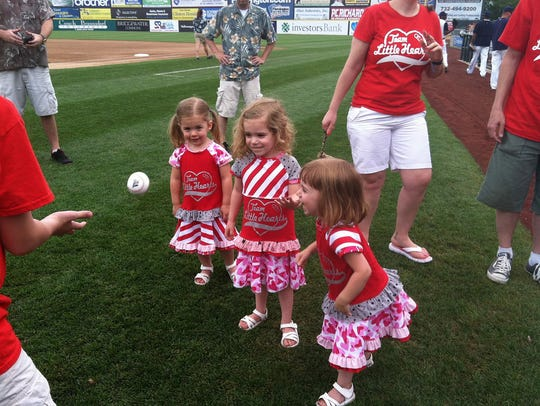 Zoe Mihalick with her sisters Ana and Eliza at an American Heart Association Heart Walk
