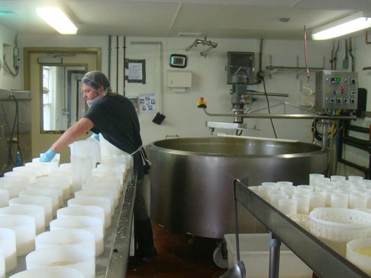 Paul Lawler, cheesemaker, at work at Cherry Grove Farm in Lawrence Township.