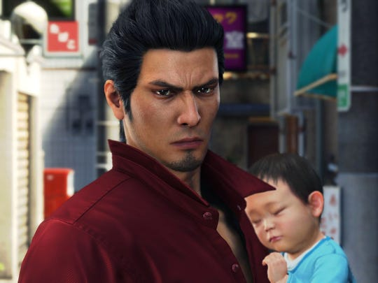 Kazuma Kiryu with baby Haruto in Yakuza 6: The Song of Life for PlayStation 4.