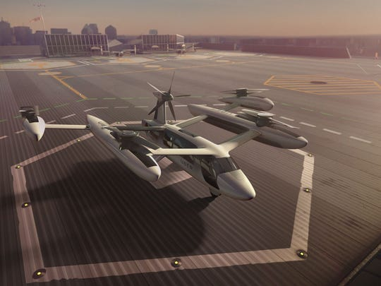This is a rendering of UberÕs VTOL concept., flying car, an electric vertical take-off and landing vehicle. (eVTOL)