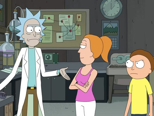 (L to R) Rick, Summer and Morty talk in the garage.