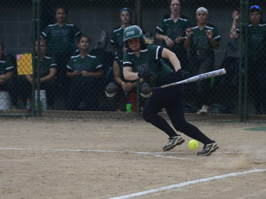 Central Dauphin shortstop Erin Delpierre drops down