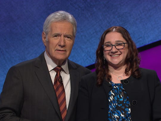 Alex Trebek (left) and Michelle Rosen (right) stand