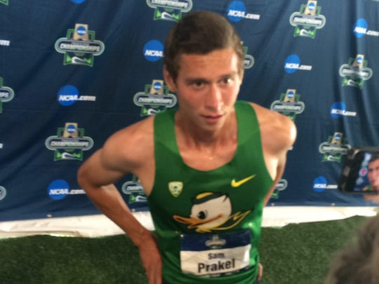 Oregon's Sam Prakel talks to the media after winning his heat in the men's 1,500 semifinal.