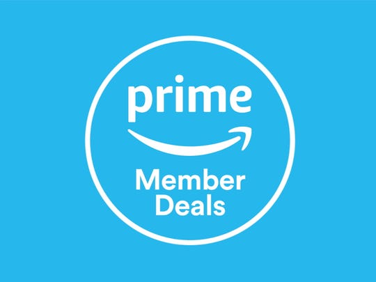 Blue sale signs indicate deals on items at Whole Foods that are exclusive to Prime members.