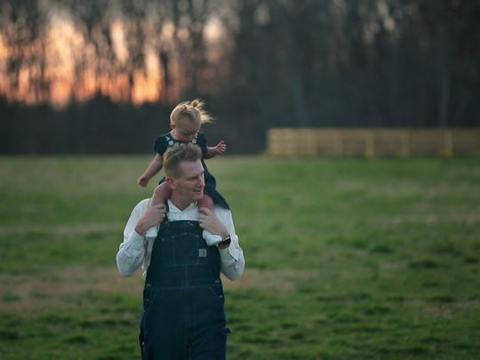 Rory Feek walks with daughter Indiana, then 2, on his