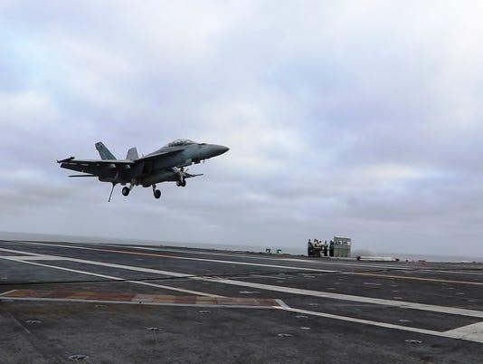 636649387041210592-Carrier-landing-photo-Medill-carriers-1-.jpg