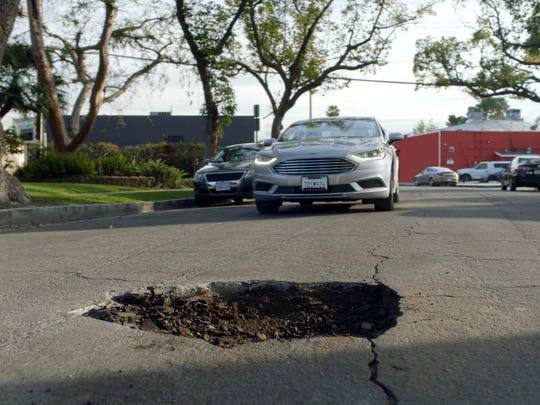 Domino's is encouraging customers to nominate their cities for grants that will pave potholes.
