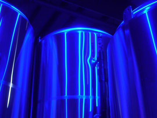 Hidden Sands Brewing Company's fermenters reflect blue
