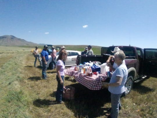More than a dozen of Jim Croff's friends and neighbors helped the Geyser rancher with haying this week.