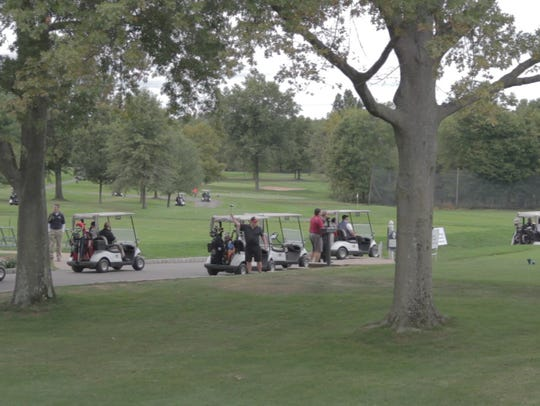 Golfers race to starting tees at a recent SCBP Golf