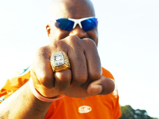 Patrick Bonner proudly sports in black college football national championship ring from the glorious 1998 season.