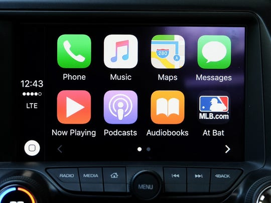 Connect your iPhone to your vehicle via USB and then put it away. Press the Siri button on the steering wheel to activate your personal assistant. You can verbally reply to text messages but not emails.