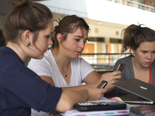 "In a scene from the ""Screenagers"" documentary, students"