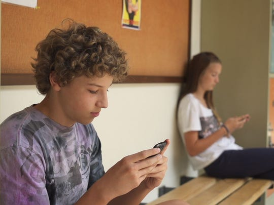 "Students keep their eyes peeled on their phones in this scene from ""Screenagers."""