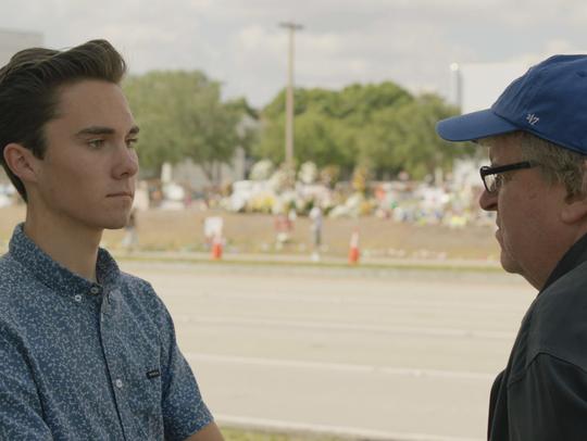 School shooting survivor David Hogg, left, and Michael