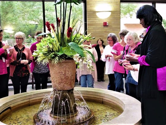 "Breast cancer survivors gathered to ""pink"" the fountain"