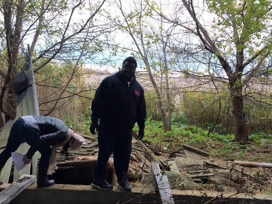 Dana Brake, 42, and Atom Perryman, 29, search an abandoned barn in Monroe County on Wednesday for signs of Chelsea Bruck, 22, who's been missing since Sunday.