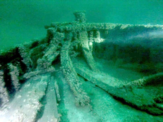 This image taken from video shows part of a 19th-century canal boat that lies on the floor of Lake Ontario's eastern end near Oswego, N.Y. Jim Kennard, Roger Pawlowski, and Roland Steven, three underwater explorers from the Rochester area, said, Wednesday, Jan. 21, 2015, that they discovered the two 19th-century canal boats last year while searching for shipwrecks.