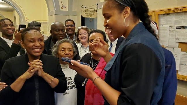 Women's basketball star Maya Moore (right) delivers the news via phone Monday to Jonathan Irons that a Jefferson City, Mo., judge overturned Irons' convictions in a 1997 burglary and assault case. Moore, a family friend, had supported Irons, sharing his story on a national basis and putting her professional career on hold to help pursue his freedom.