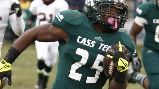 Detroit Cass Tech running back Mike Weber, a former Michigan commitment, signed with Ohio State on Wednesday.