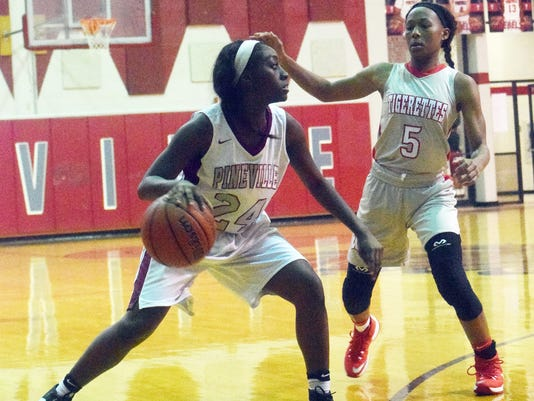 Pineville's Hailee Wilkins (24, left) looks to pass againt Winnfield's Tyra Triplett (5, right) Tuesday.