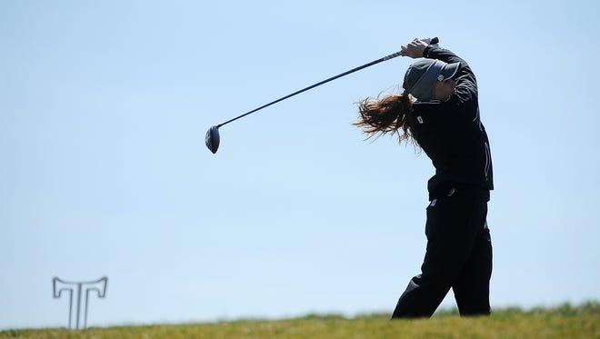 Roosevelt's McKayla Poppens tees off on the 5th hole at the Country Club of Sioux Falls on Monday, April 20, 2015, during the Girls City Golf Meet in Sioux Falls.
