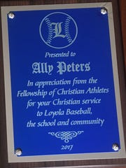 Ally Peters recently received this FCA plaque for her work at Loyola.
