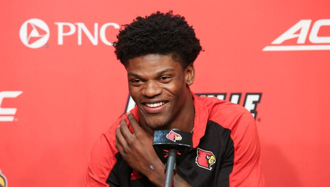 U of L QB Lamar Jackson smiled as he spoke to the media following the announcement that he is a finalist for the Heisman Trophy.  Dec. 5, 2016