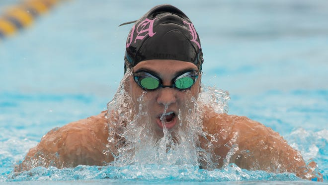 Lincoln Park Academy's Kayla Glennon swims the breaststroke leg of the 200-yard medley relay during the St. Lucie County Senior Swimming and Diving Meet at Indian River State College on Wednesday, October 4, 2017, in Fort Pierce.