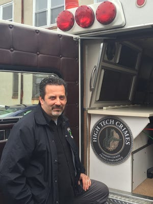 Det. Sgt. Tom DiNunzio stands by the mobile lab of the High Tech Crimes Unit at the Camden County Prosecutor's Office.