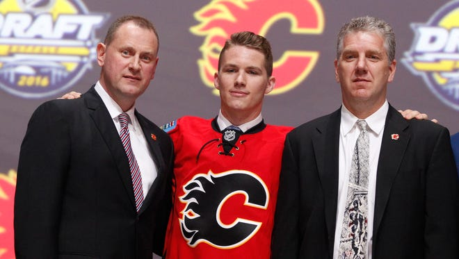 Matthew Tkachuk poses for a photo after being selected as the No. 6 pick by the Calgary Flames.