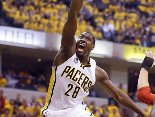 Ian Mahinmi (28) drives the ball through the Toronto