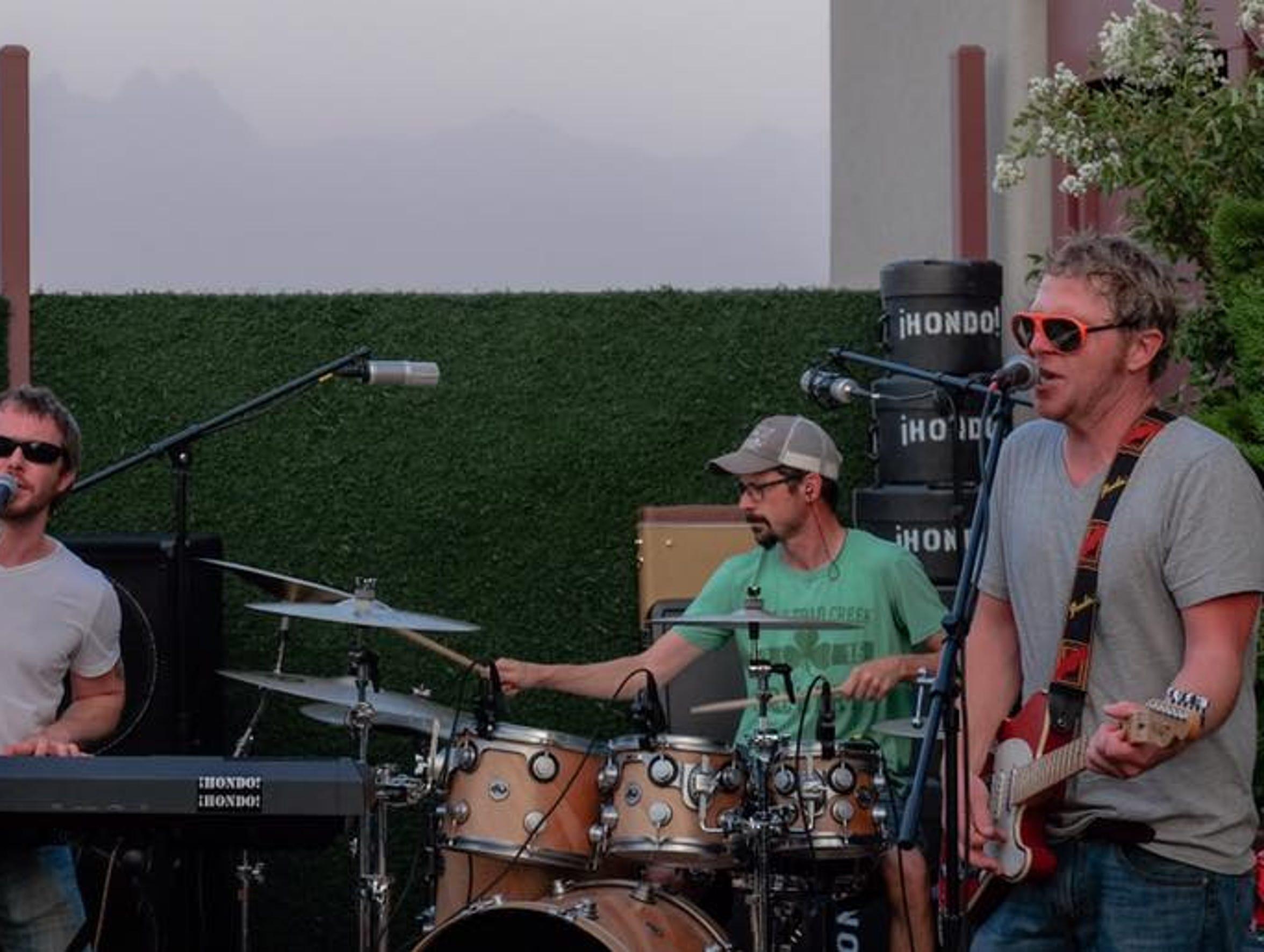 Local rock band ¡HONDO! ¡HONDO! consists ofNeal Adelman (guitar, vocals),Alex Hallwyler (keyboard, vocals),Russell Larcher (bass) and Matt Swanson (drums).