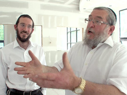 Shaya Ilowitz (right) and his son Sol Ilowitz are shown at their under construction offices for Prime Insurance on East County Line Road.