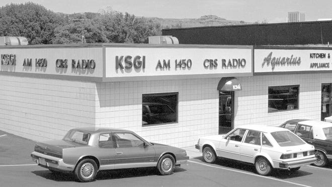 In April of 1989, the offices of KSGI, a local AM radio station that broadcast at 1450 on the dial, were located in the building seen in the then photo taken from the Spectrum & Daily News' negative archives. The station was sold to Simmons Media group in 1998, which subsequently changed the call sign of the station, eventually landing on KZNU. It is still broadcasting as Fox News 1450.  The Aquarius Kitchen and Bath store that can be seen in the then image is also long gone from St. George. The building was the home of a few different businesses after the radio station left, but for the past several years has been occupied by Power Image, a St. George based screen printing and design company, as can be seen in the now image taken by Spectrum photographer Jud Burkett. The Aquarius Kitchen and Bath store that can be seen in the now image is also long gone from St. George. The building was the home of a few different businesses after the radio station left, but for the past several years has been occupied by Power Image, a St. George based screen printed and design company, as can be seen in the now image taken by Spectrum photographer Jud Burkett.