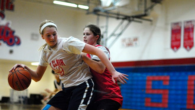 Saints' Brooke Mahn backs down a defender Monday, Nov. 30, during practice before their season opener.