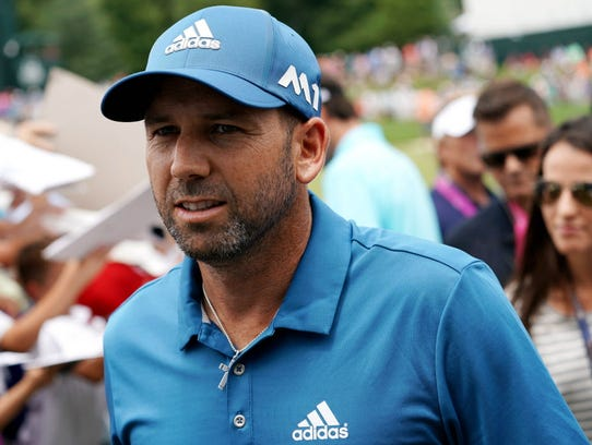 Sergio Garcia leaves the 18th green during a practice