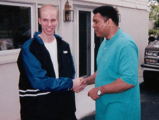 Tod Pfister shakes hands with Muhammad Ali.