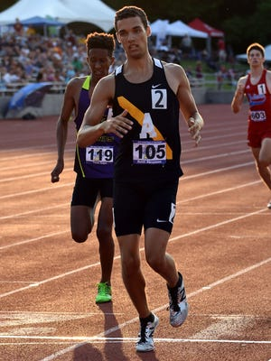 Avon's Keith Abramson crosses the finish line in the first heat of the 800 meter run during the boys IHSAA track and field state finals at Robert C. Haugh Track and Field complex in Bloomington, Ind. on Saturday, May, 2, 2018.