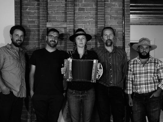 Rose and the Bros perform Thursday at the Loft above the Carriage House Café.