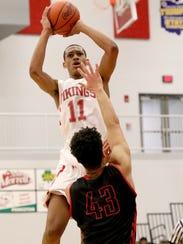 Princeton's Darius Bazley shoots the ball.
