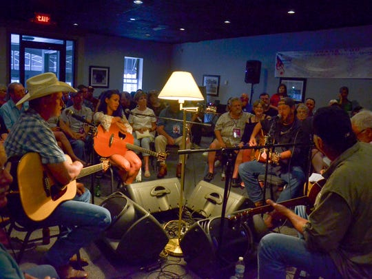 Fans listen as Joel Shewmake plays a song during the Sandy Lee Watkins Songwriters Festival at Rookie's in Henderson, Wednesday, July 26, 2017.