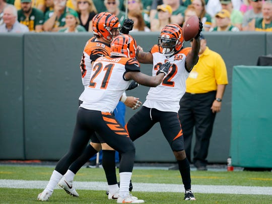 Cincinnati Bengals cornerback Darqueze Dennard (21) celebrates with Cincinnati Bengals cornerback William Jackson (22) after Jackson's pick-6 in the second quarter of the NFL Week 3 game between the Green Bay Packers and the Cincinnati Bengals at Lambeau Field in Green Bay on Sunday, Sept. 24, 2017.