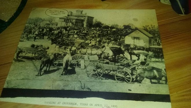 """According to the Minneapolis NAACP, Tyrone Williams and Chauntyll Allen were preparing to dine at Joe's Crab Shack Wednesday night when they noticed a photo embedded inside the table. It appears to show a large group of white people watching a public execution of at least one black person. On the bottom of the picture, it reads: """"Hanging at Groesbeck, Texas on April 12th 1895."""" At the top, the caption reads, """"All I said was that I didn't like the gumbo."""""""